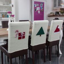 Modell 817/3, glatt rechts gestrickte Stuhlhussen mit separat gehäkelten Weihnachtlichen Motiven